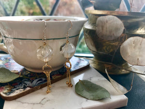 Gold and white botanical earrings