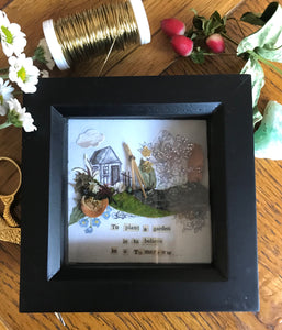 'To plant a garden' shadow box