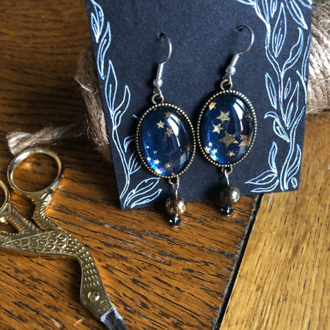 Blue and gold star earrings