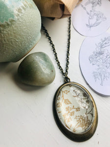 Gold and cream vintage print pendant