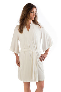 woman wearing bamboo white robe comfy sustainable quarantine tips