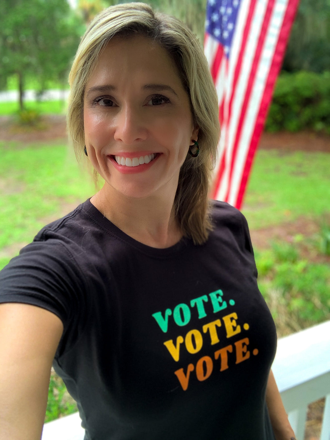 woman wearing a vote t-shirt