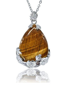 Tiger's Eye Natural Stone Pendant Necklace...  Tiger's Eye is a stone of protection that is also very stabilizing and grounding. It enhances integrity, willpower, self-confidence, practicality and correct use of power. It is a stone that enhances good luck and brings prosperity, often in the form of money.