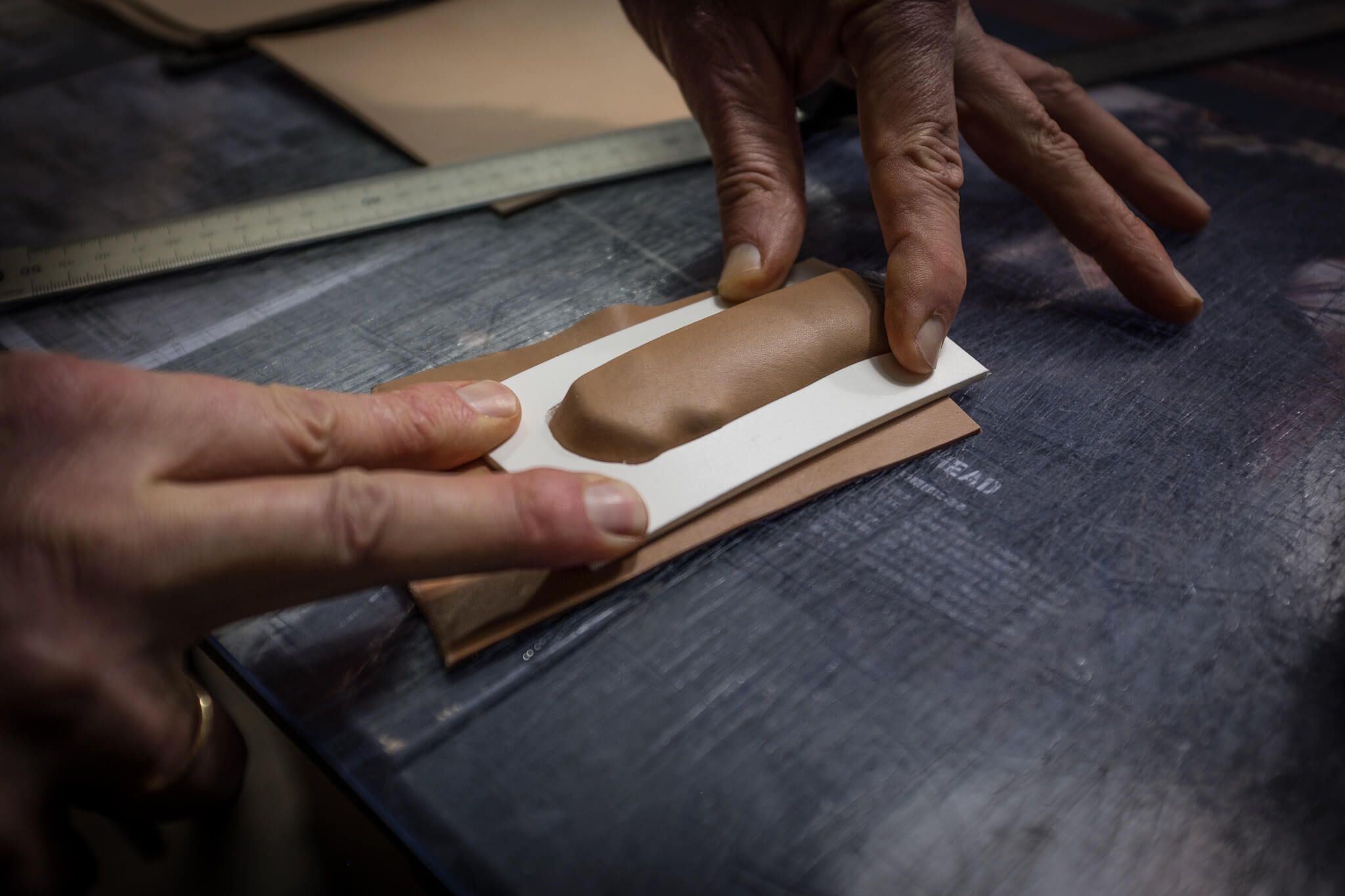 Positioning the soaked leather and the mold | Duke & Sons Leather