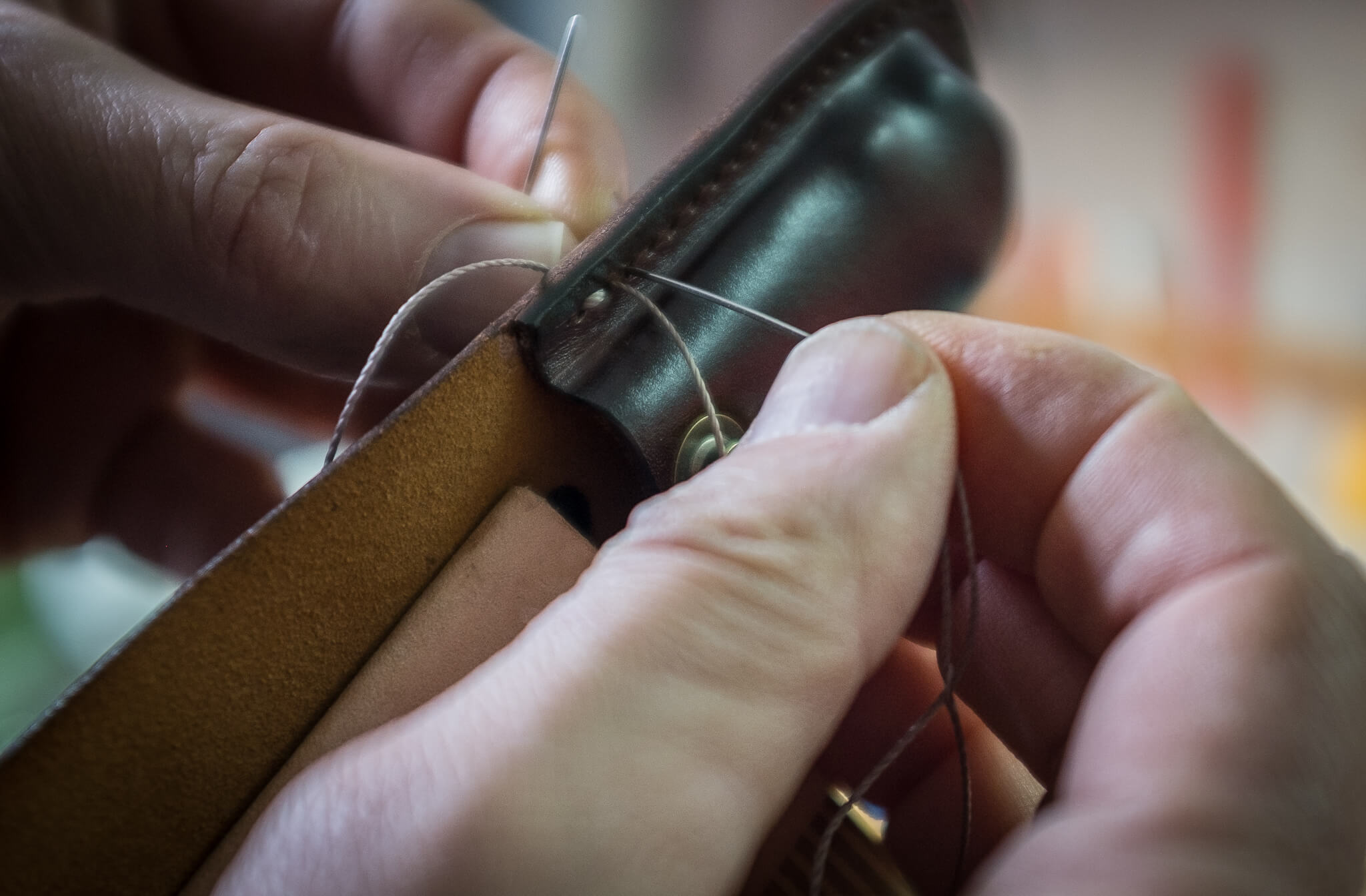 Handstitching the leather knife sheath | Duke & Sons Leather