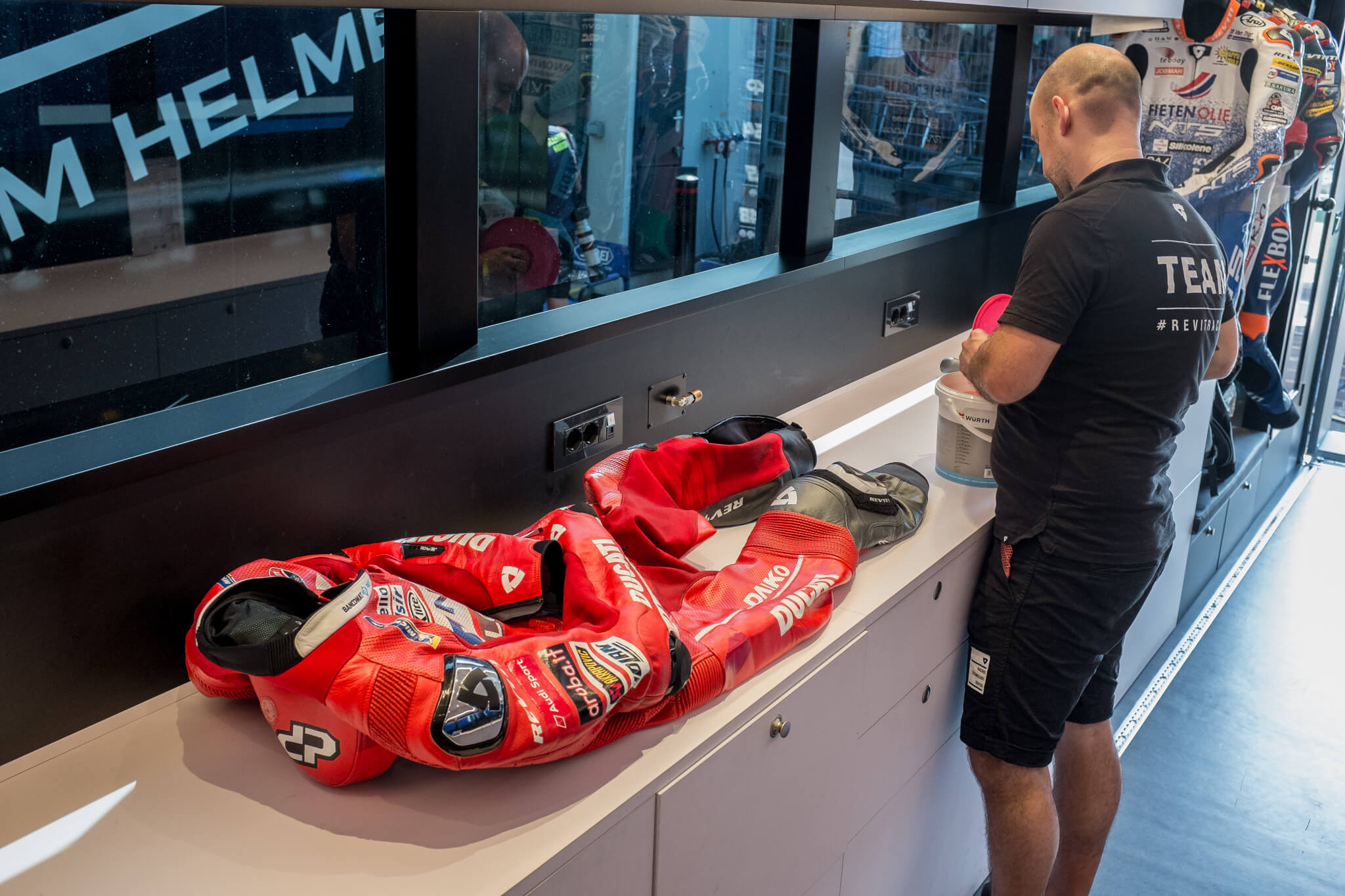 REV'IT! service manager Michiel is taking care of Danilo Petrucci's suit after the race