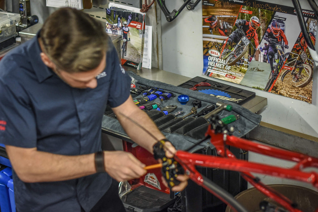 Jonathan Duncan working on a professional bike