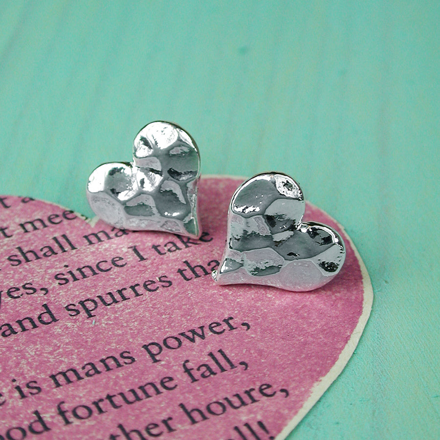Heart earrings with a gently beaten silver plated finish