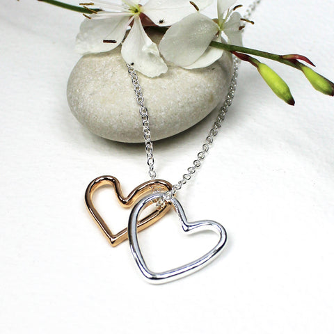 Pretty delicate necklace featuring 2 open hearts