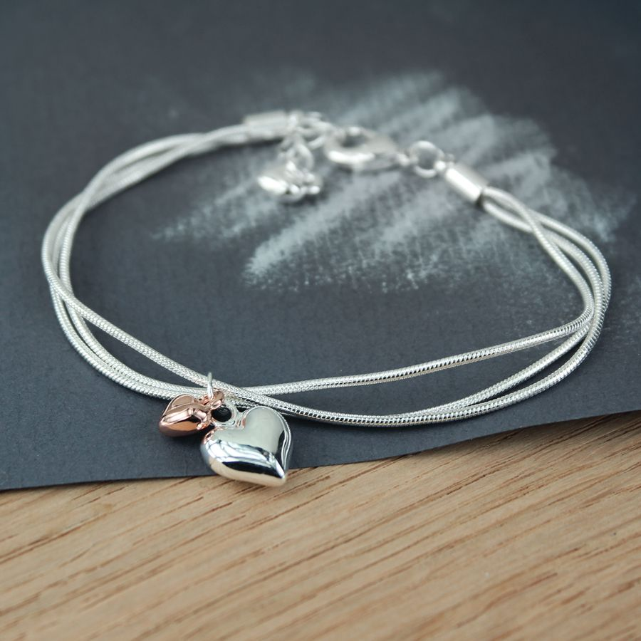 Silver plated triple chain bracelet with a silver plated heart and a rose gold plated heart