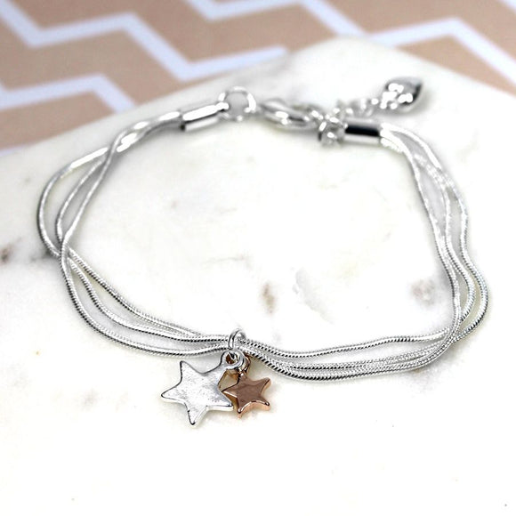 Silver plated triple chain bracelet with a silver plated star and a rose gold plated star