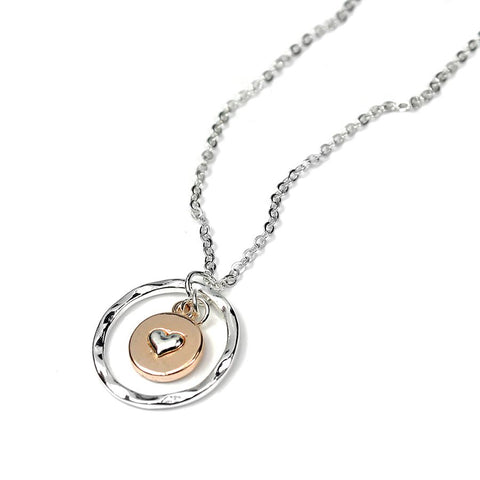 Silver plated fine chain necklace with a textured silver plated ring and a round disc in a rose gold style finish with a little silver plated heart inside.