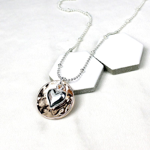 Decorative silver plated fine chain necklace with rose gold plated beaten concave disc and silver plated puff heart