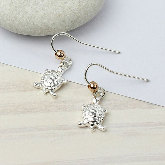 Silver plated turtle dropper earrings.