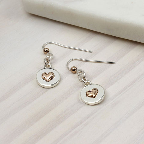 Polished silver plated round disc drop earrings with heart inlays in a rose gold style finish.