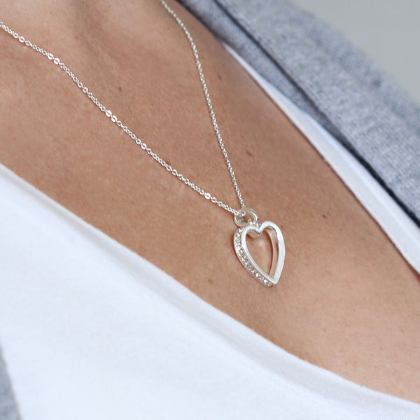 Inset crystal heart necklace being worn