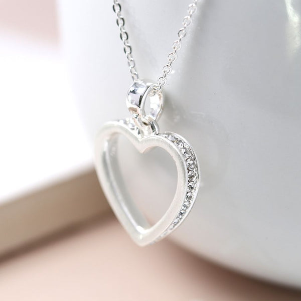 Silver plated fine chain necklace with a brushed silver plated open heart edged with tiny crystals