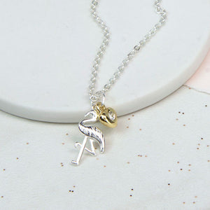 Fine chain silver plated necklace with a gold silver crystal heart and a silver plated flamingo charm.