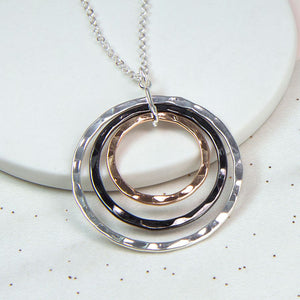Triple hoop necklace in a hammered texture with silver plated, rose gold and hematite style finishes