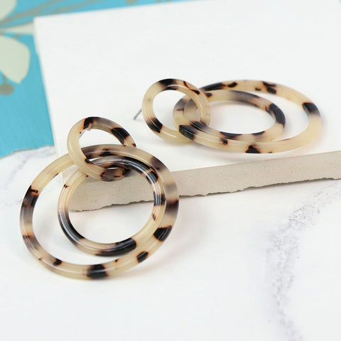 Resin lightweight triple hoop earrings, with double hoops linked through a single hoop stud, in a taupe tortoise shell finish.