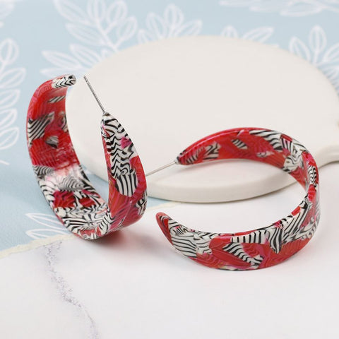 Gorgeous acrylic lightweight open hoop earrings in a red and zebra stripe design