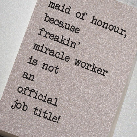 A fabulously sparkling silver glitter effect covered notebook featuring in the slogan: Maid of Honour because freakin' miracle worker is not an official job title.