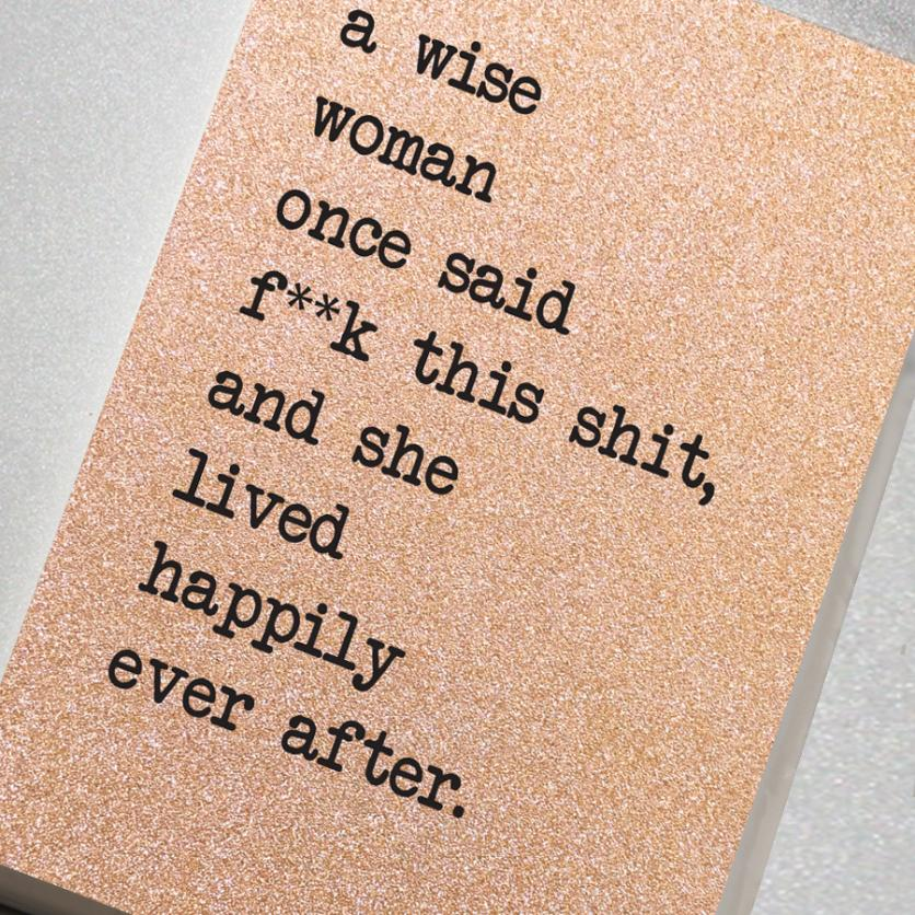 A fabulously sparkling rose gold glitter effect covered notebook featuring in the slogan: A Wise Woman Once Said F**K This Shit, and She Lived Happily Ever After.