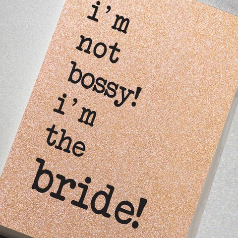 A fabulously sparkling rose gold glitter effect covered notebook featuring in the slogan: I'm Not Bossy! I'm the Bride!