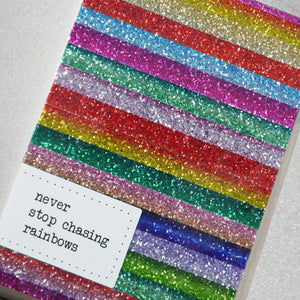 This perfectly sparkly notebook is handmade from glitter fabric featuring a beautiful multicolour rainbow stripe design.