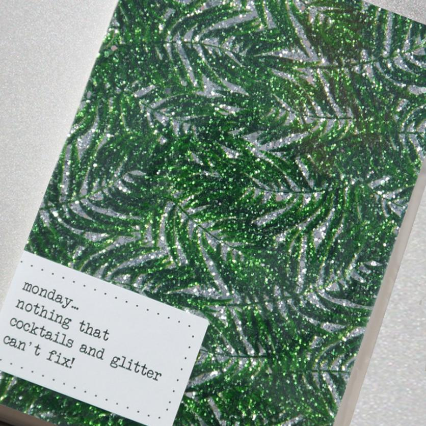 This super sparkly notebook is handmade from glitter fabric featuring a gorgeous green and silver tropical leaf design.
