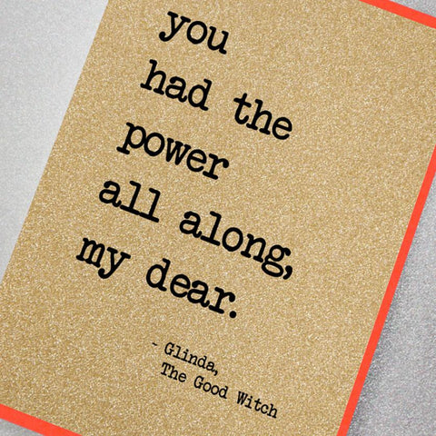 sparkly gold glitter effect greeting card featuring the famous The Wizard of Oz slogan: You had the power all along my dear. (Glinda, The Good Witch)