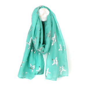 Dream of the seaside with this aqua green scarf with metallic silver foil starfish print