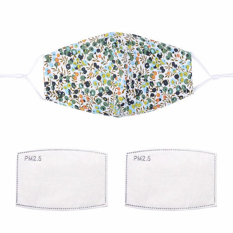 Fashionable face mask with a white and green currant printed fabric design.