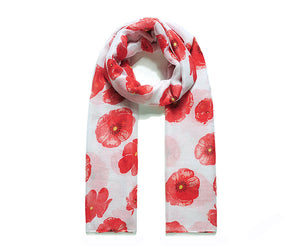A beautiful white scarf printed with a vibrant red poppy design.