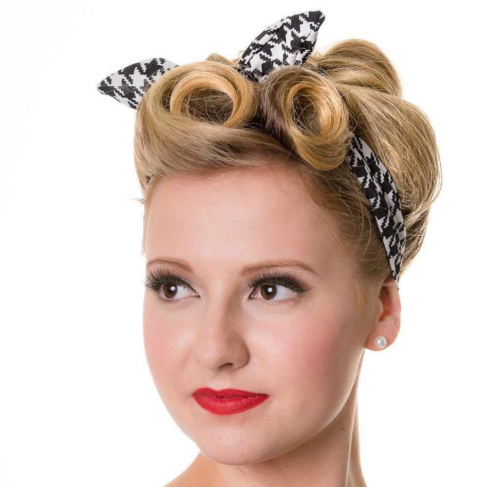 Girl modelling black and white houndstooth vintage style headband