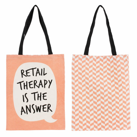 Orange tote bag with speech bubble and the slogan retail therapy is the answer