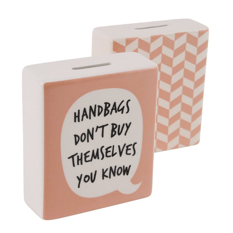Pink money box with speech bubble slogan Handbags Don't Buy Themselves You Know