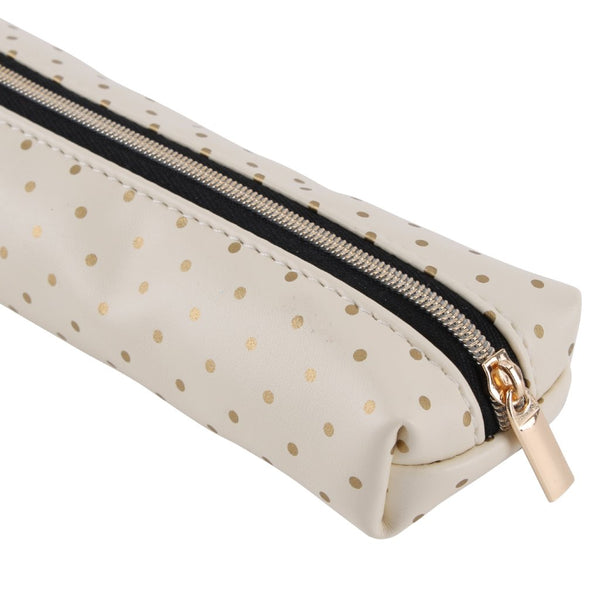 Cream make up brush bag with gold polka dot design.