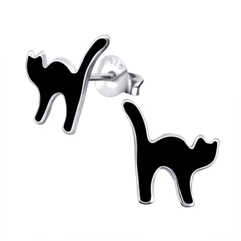 Stretching black cat stud earrings.