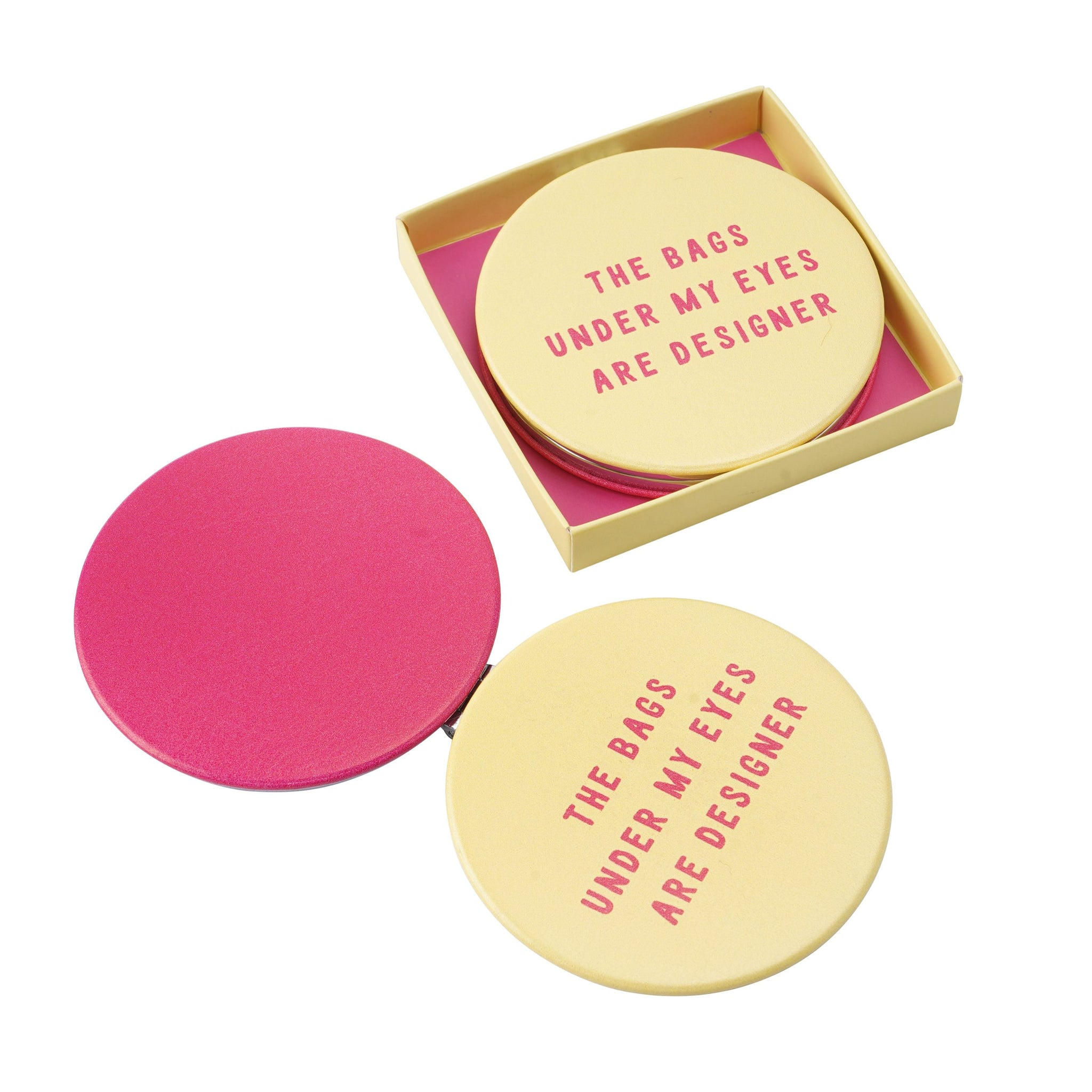 Yellow and pink compact mirror, with the fun slogan The bags under my eyes are designer.