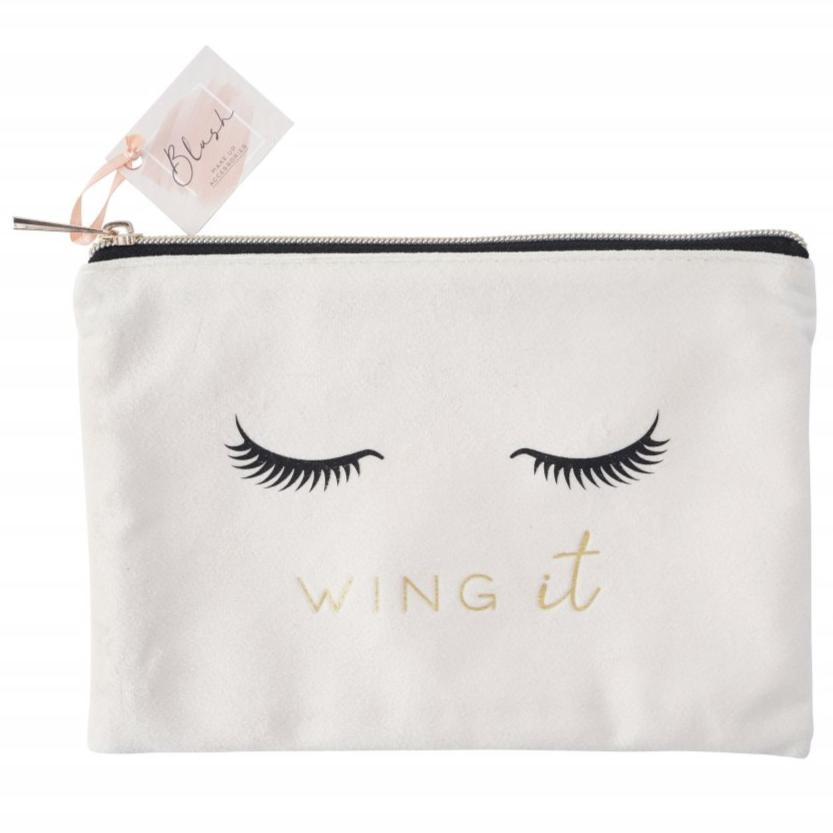 Pretty eye lash design make up bag featuring the phrase Wing It