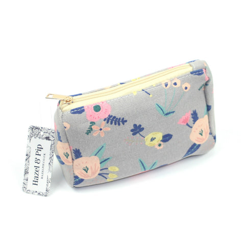Grey pastel floral print design make up bag.