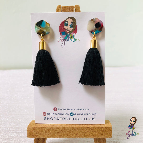 black cotton tassel drop earrings are finished with a vibrant coloured hexagon acrylic ear stud.