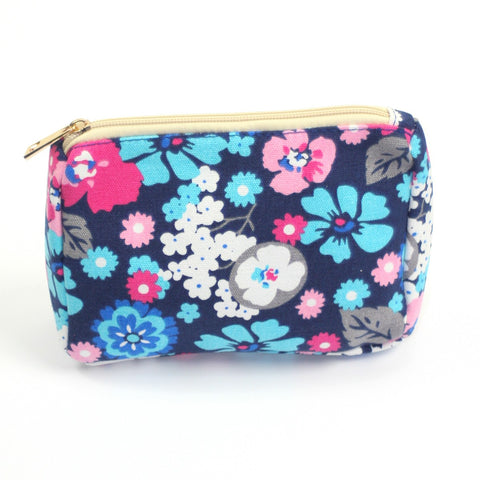 Bright blue and pink floral print make up bag