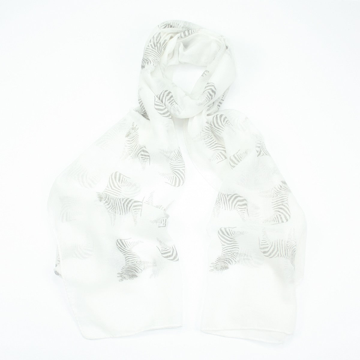 Fun light grey zebra design on a white background printed scarf.