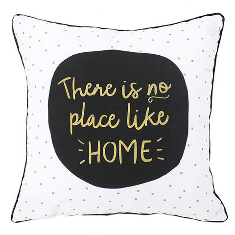 Black, white and gold cushion featuring phrase There Is No Place Like Home