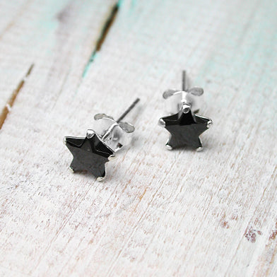 Sterling silver stud earrings with faceted crystal stars.  Choice of black, clear or purple.