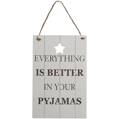 Wooden sign with a vintage chic look and featuring the slogan: Everything is Better in your Pyjamas.
