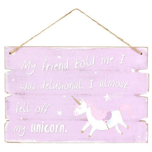 Pretty sign in lilac with unicorn design and includes slogan: My Friend Told Me I Was Delusional, I Almost Fell Off My Unicorn