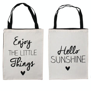 White canvas shopping bag featuring choice of slogans